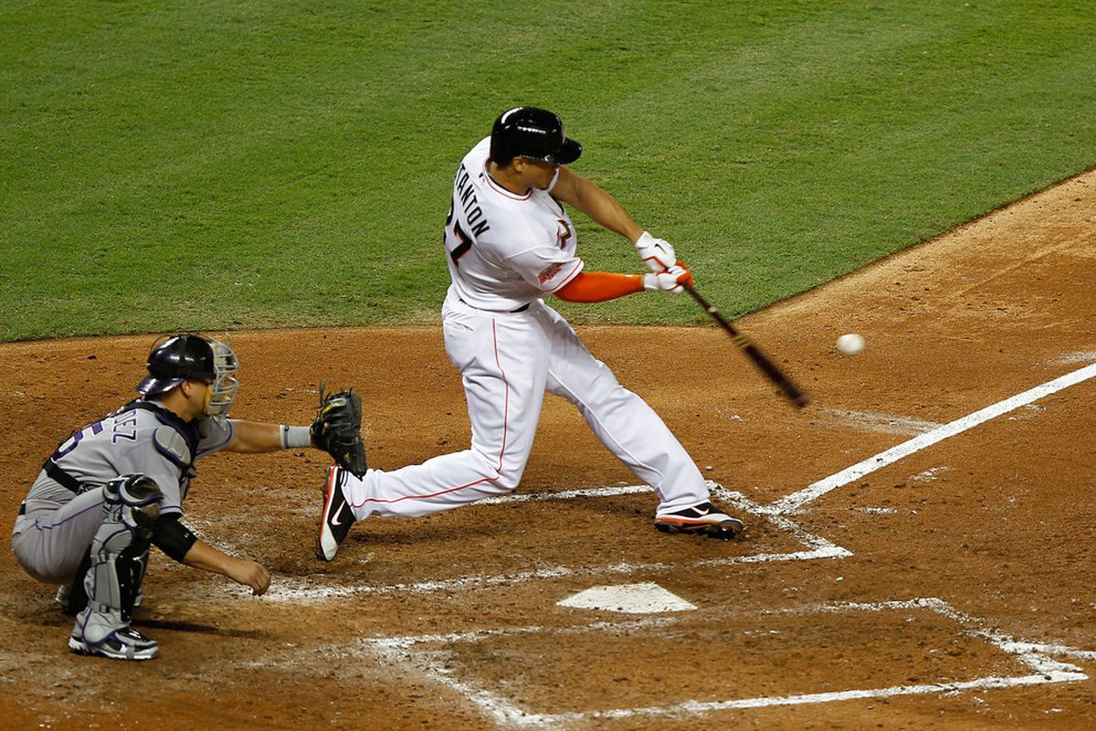 MIAMI, FL - MAY 21:  Giancarlo Stanton #27 of the Miami Marlins hits a grand slam during a game against the Colorado Rockies at Marlins Park on May 21, 2012 in Miami, Florida.  (Photo by Mike Ehrmann/Getty Images)