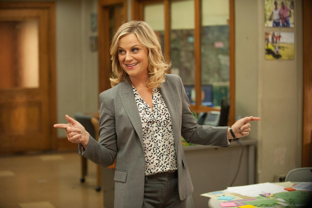 """Amy Poehler stars as Leslie Knope in """"Parks and Recreation."""" The original cast of the show has reunited for a special coronavirus-themed episode to benefit charity."""