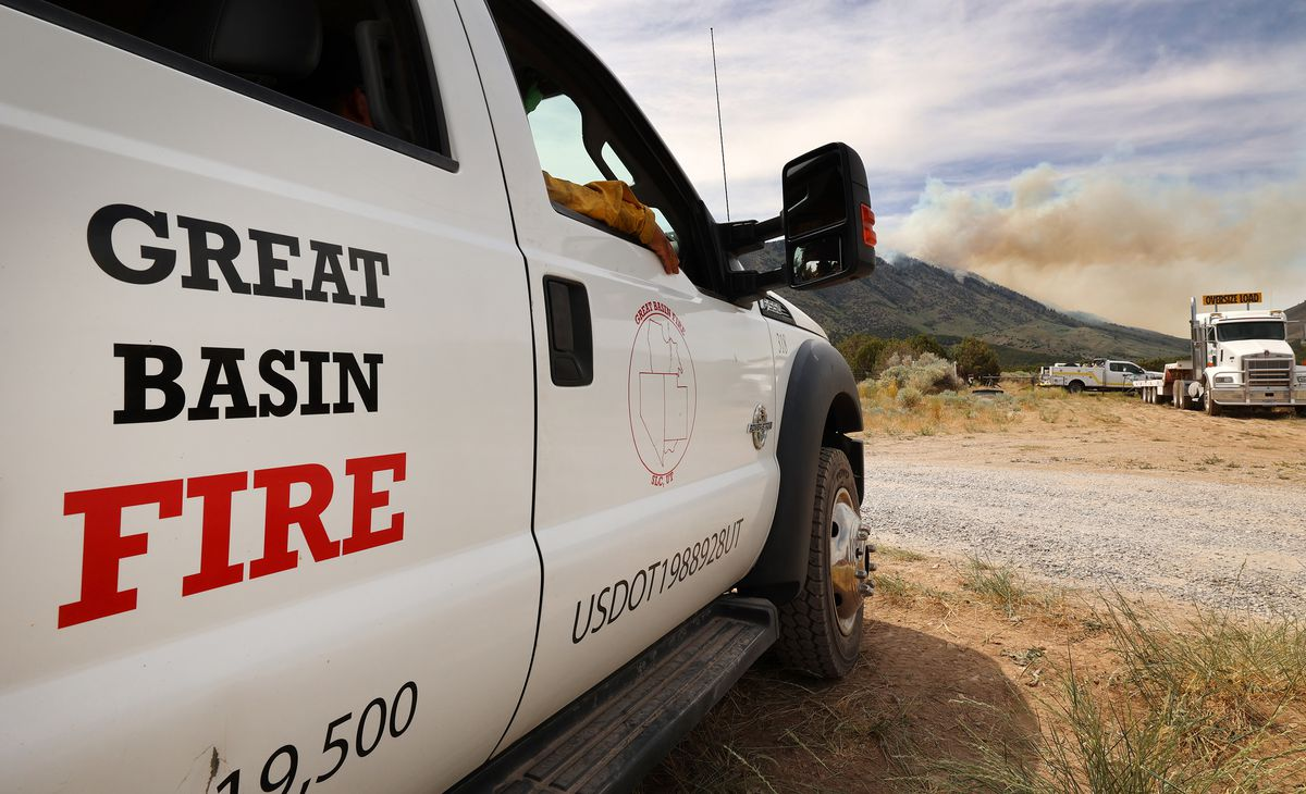 Firefighters from Great Basin Fire keep watch on a wildfire burning on Victory Mountain in Morgan Canyon in Tooele County on Tuesday, June 22, 2021. The fire started after a plane crash.