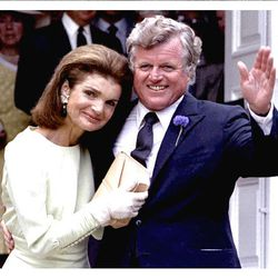 Jacqueline Kennedy Onassis and Edward Kennedy embrace at the wedding of her daughter, Caroline, to Edwin Schlossberg on July 19, 1986.