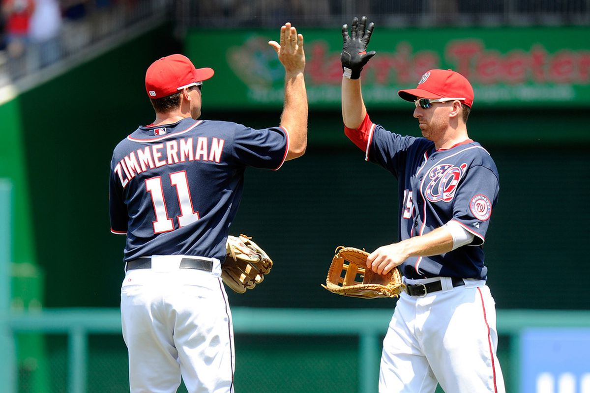 WASHINGTON, DC - JULY 04:  Ryan Zimmerman #11 of the Washington Nationals celebrates with Adam LaRoche #25 after a 9-4 victory against the San Francisco Giants at Nationals Park on July 4, 2012 in Washington, DC.  (Photo by Greg Fiume/Getty Images)