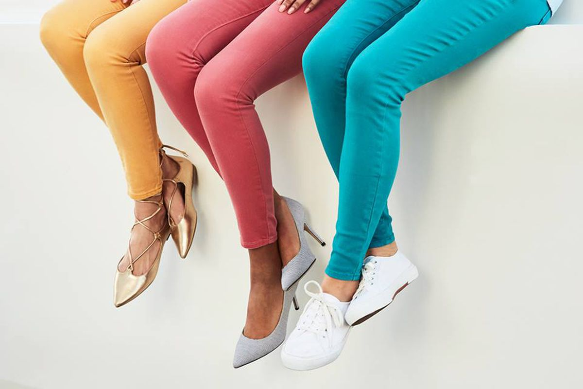 Three women in colorful pants