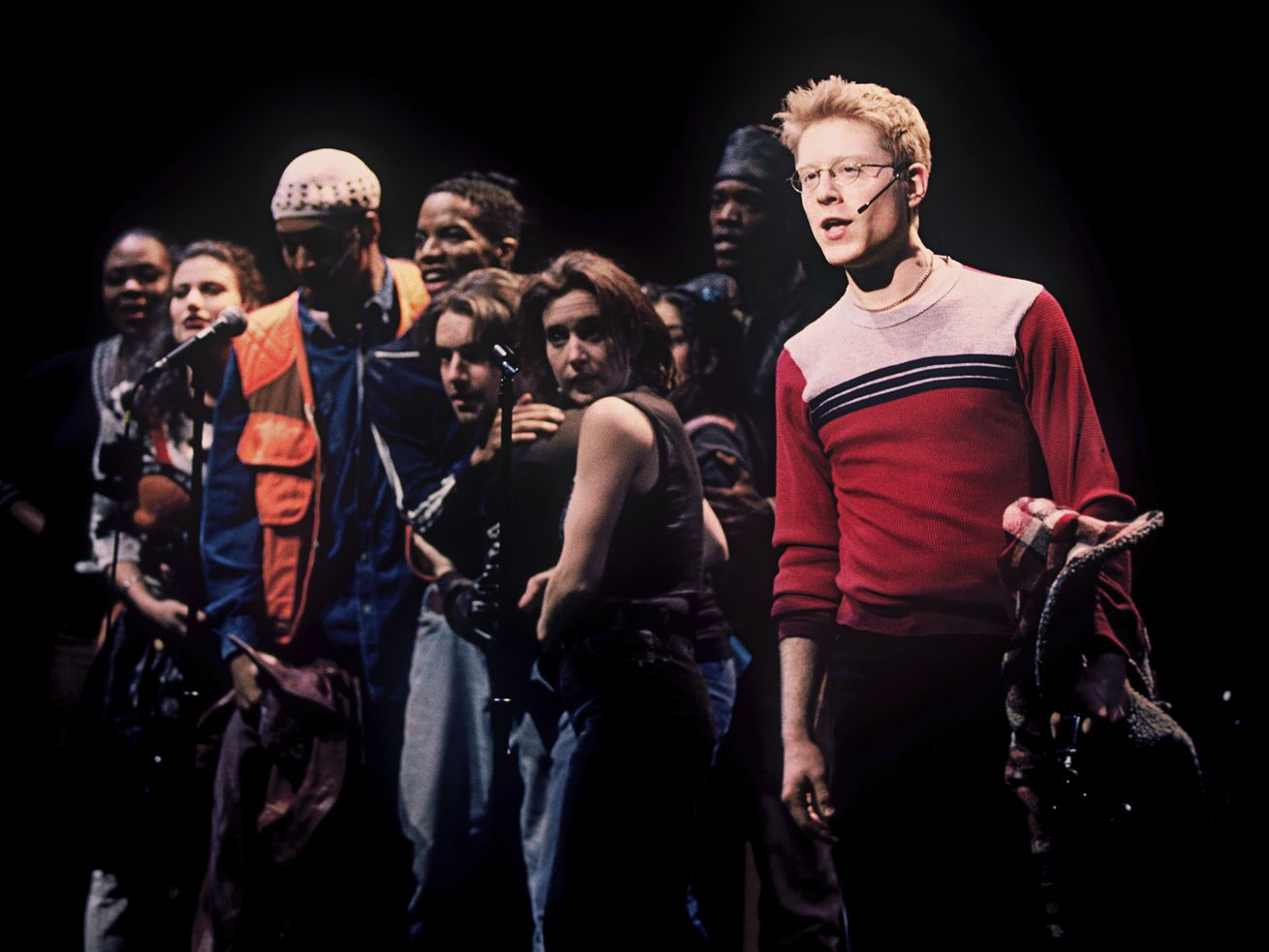"""Anthony Rapp (right) and the cast appear during a performance of the 1996 musical """"Rent"""" in New York."""