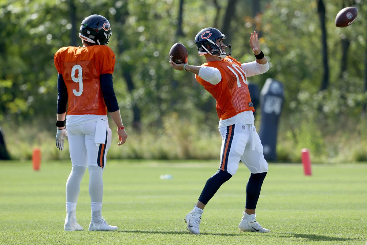 Mitchell Trubisky of the Chicago Bears throws a pass as Nick Foles looks on during training camp at Halas Hall on September 02, 2020 in Lake Forest, Illinois.