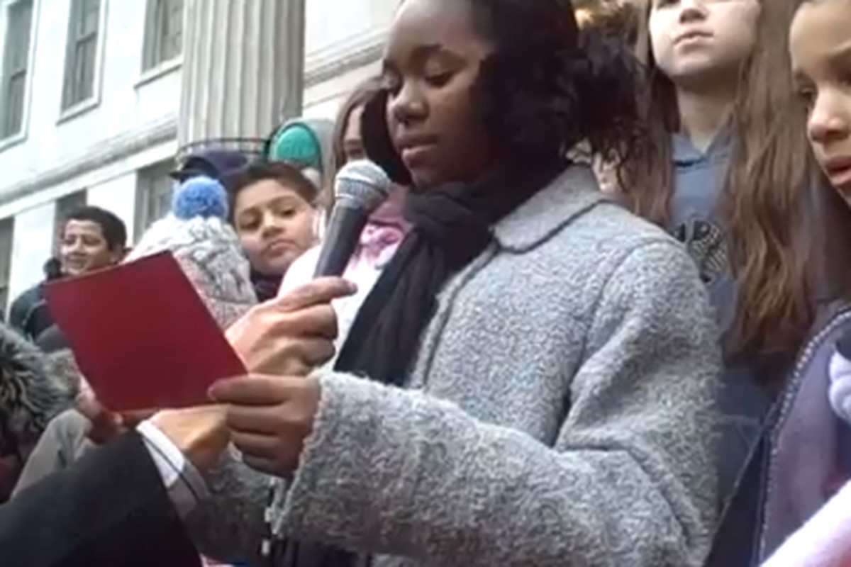 """A student at P.S. 261 in Brooklyn recites part of Martin Luther King's """"I have a dream"""" speech during the school's march on Friday."""