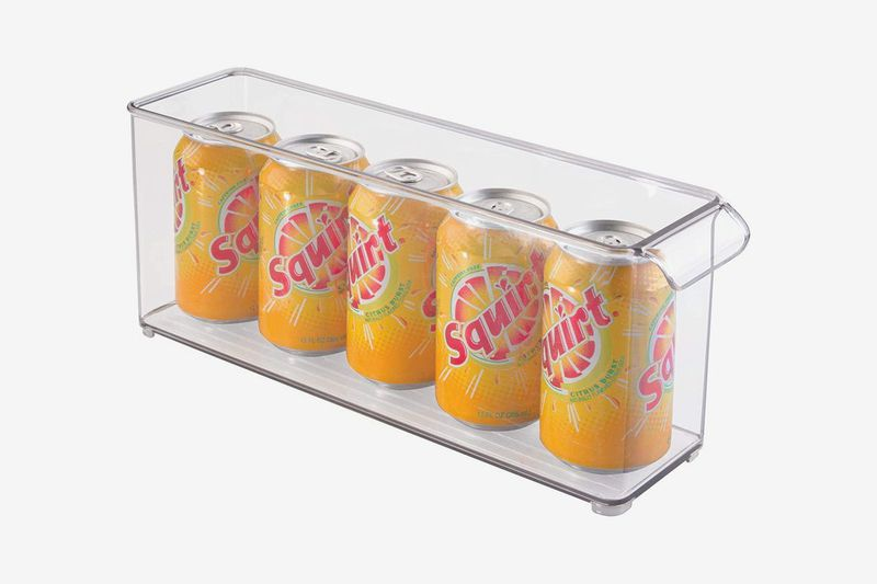 Clear container with a row of canned soda.