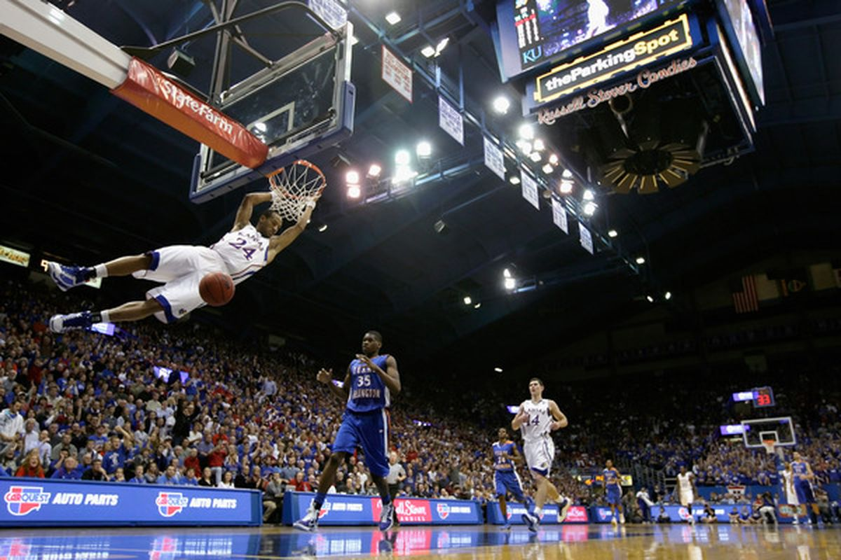 LAWRENCE KS - DECEMBER 29:  Travis Releford #24 of the Kansas Jayhawks dunks during the game against the University of Texas Arlington Mavericks on December 29 2010 at Allen Fieldhouse in Lawrence Kansas.  (Photo by Jamie Squire/Getty Images)