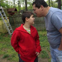 Stuart Chaifetz kisses his son Akian Chaifetz, 10, on the head as they play in the backyard of their home in Cherry Hill, N.J., Wednesday, April 25, 2012. After Chaifetz was told that his son Akian was acting violently at his New Jersey school he decided to investigate. Akian's autism prevented him from being able to explain to his father if anything had been happening to him at school. Chaifetz decided the only way to find out what was behind the outbursts was to send his boy to school wearing a hidden audio recorder. While Akian's teacher and colleagues denied anything out of the ordinary was happening, the recordings Chaifetz listened to told a different story.