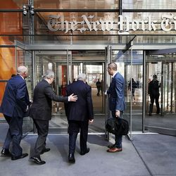 President M. Russell Ballard, center right, acting president of the Quorum of the Twelve Apostles, and Elder Jack N. Gerard, General Authority Seventy, center left, of The Church of Jesus Christ of Latter-day Saints, enter The New York Times building for an interview in New York City on Friday, Nov. 15, 2019.