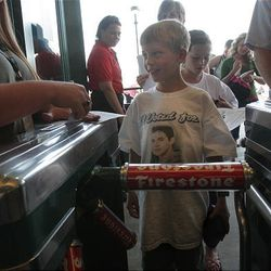 Eight-year-old Jacob Davis enters the E Center in West Valley for the American Idols Live concert on Monday night.
