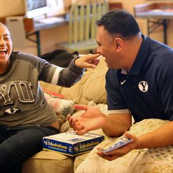 Skye Sitake plays Telestrations with her father Kalani Sitake at home in Provo on Friday, March 11, 2016.