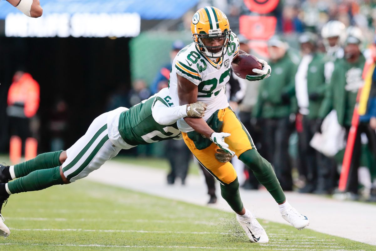 Green Bay Packers wide receiver Marquez Valdes-Scantling gains yards after catch as New York Jets cornerback Darryl Roberts tackles during the second half at MetLife Stadium.