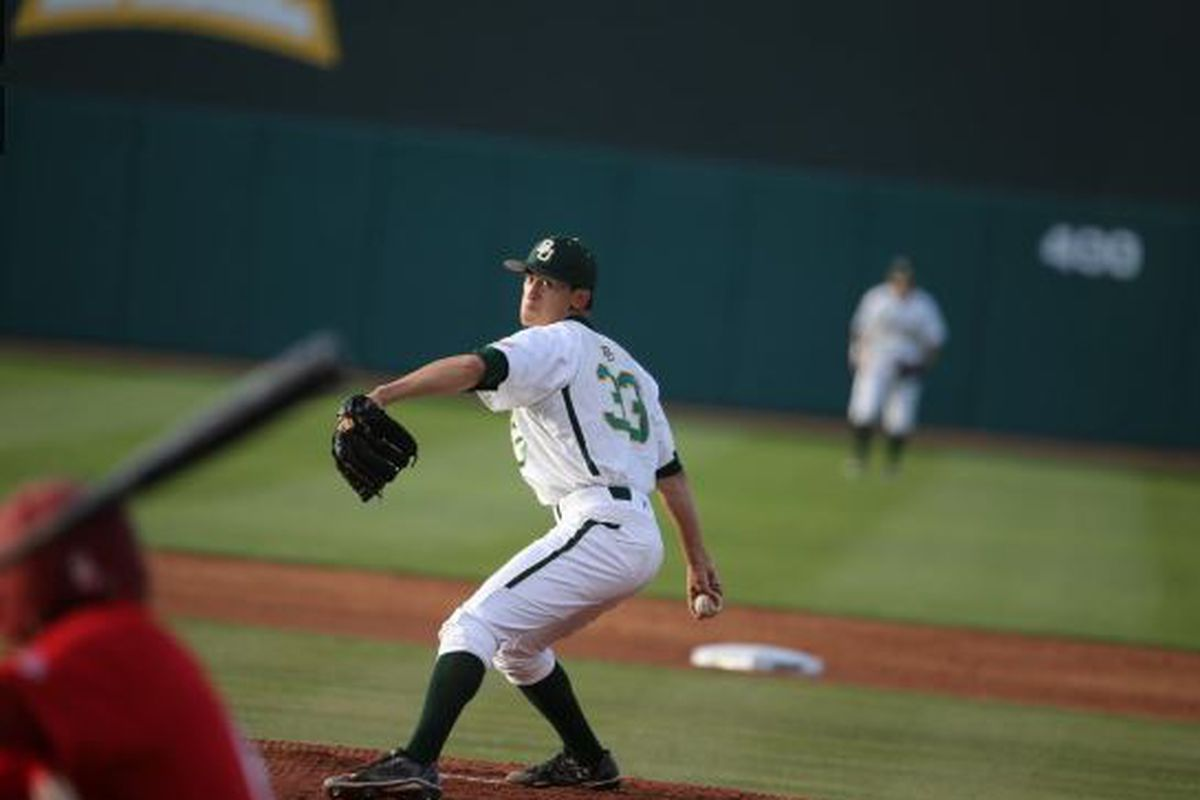Theron Kay faces a batter during the U of H midweek game last week.