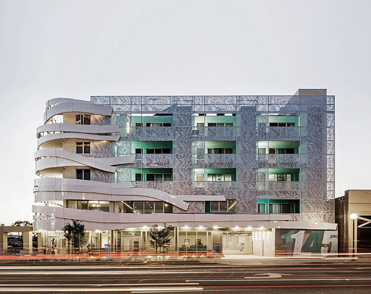 This arty building in West Hollywood is home to very low-income, formerly homeless LGBT youth and people living with HIV and AIDS. It was designed by Patrick Tighe Architecture & John V. Mutlow Architects Inc.