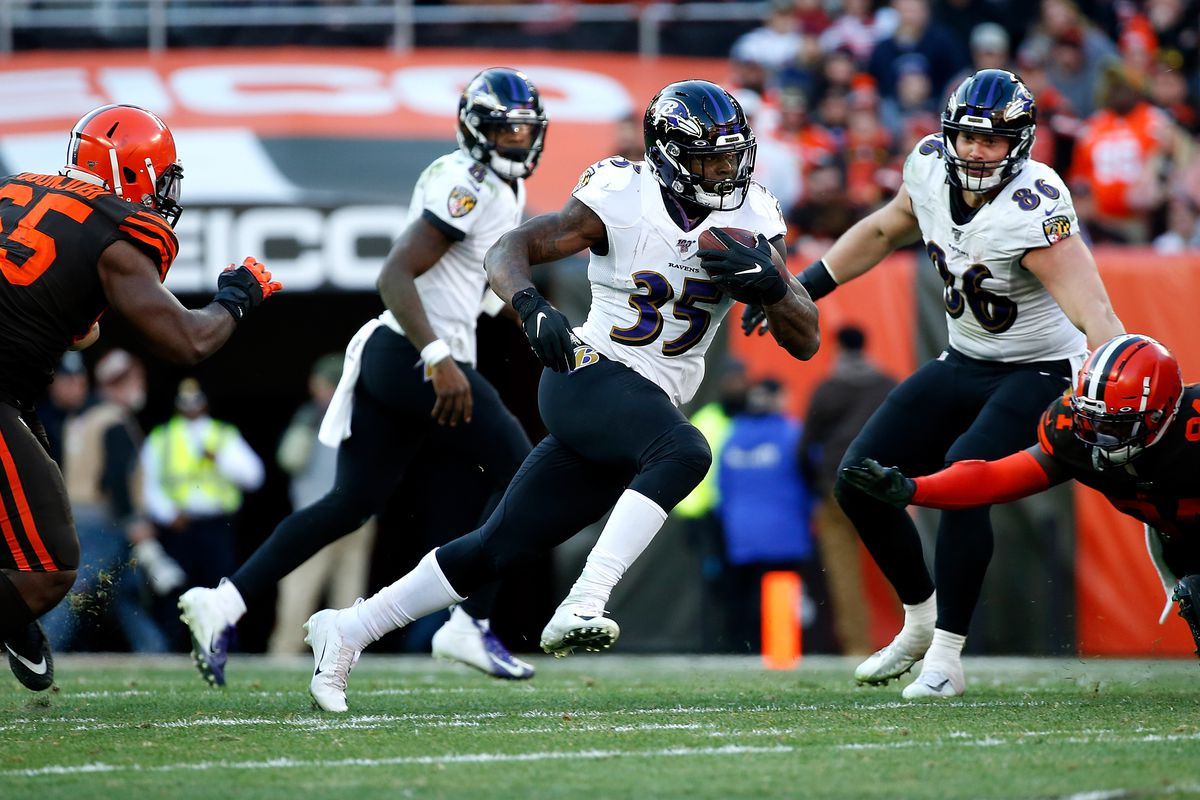 Gus Edwards of the Baltimore Ravens runs with the ball during the game against the Cleveland Browns at FirstEnergy Stadium on December 22, 2019 in Cleveland, Ohio.