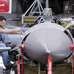 Hill Air Force Base worker and aircraft electrician Jeremy John works on an F-16, March 17, 2005.