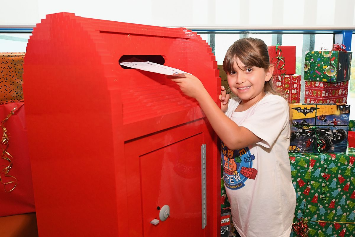 Children Add Finishing Touches To Life Size LEGO Christmas Showcase