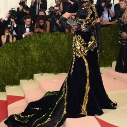Katy Perry wears a Prada gown, black lips, and a Tomagatchi.