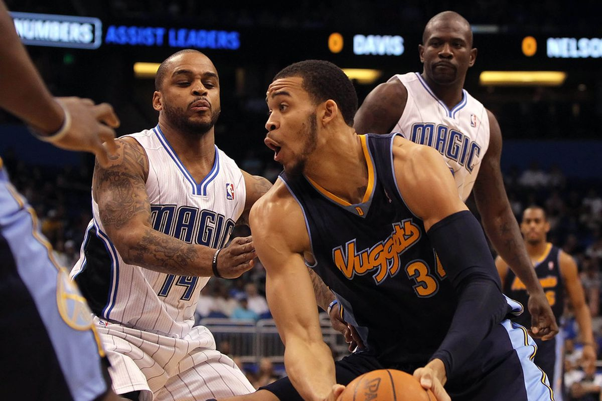 April 1, 2012; Orlando FL, USA; Denver Nuggets center JaVale McGee (34) drives to the basket as Orlando Magic point guard Jameer Nelson (14) defends during the first half at Amway Center. Mandatory Credit: Kim Klement-US PRESSWIRE