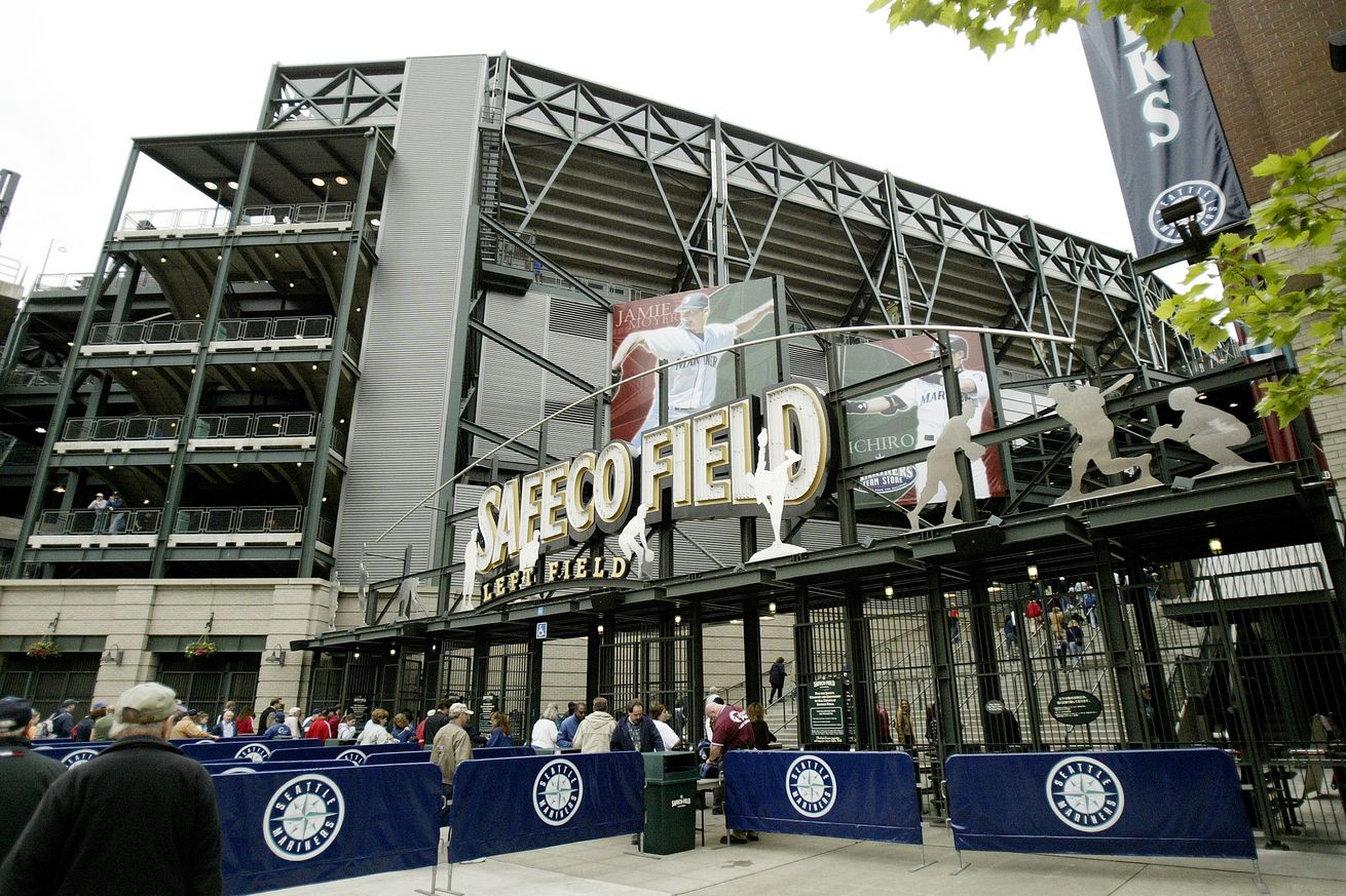 A view of a gate at Safeco Field as fans file in through lines marked by Seattle Mariners bunting.