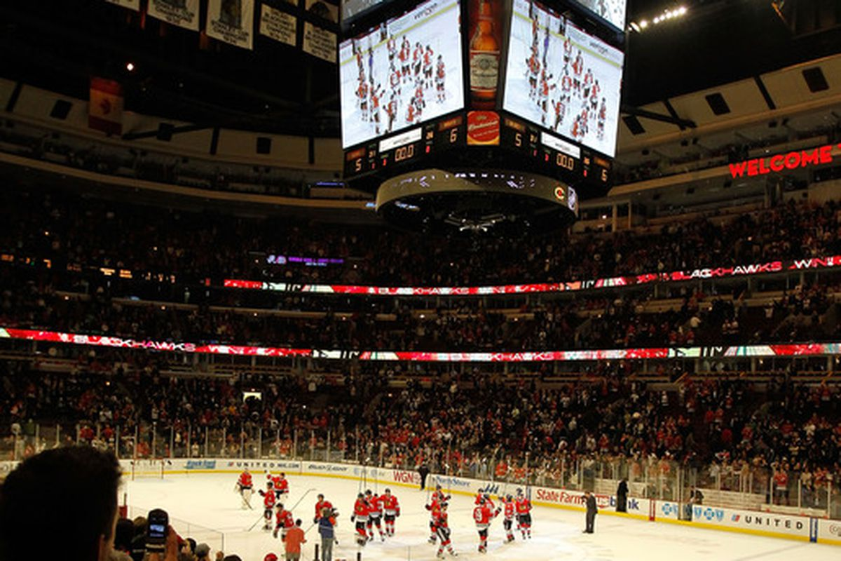 CHICAGO - APRIL 07: Members of the Chicago Blackhawks salute the crowd following a win over the St. Louis Blues at the United Center on April 7, 2010 in Chicago, Illinois. The Blackhawks defeated the Blues 6-5. (Photo by Jonathan Daniel/Getty Images)