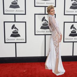 Paris Hilton breaking this year's conservative red carpet with a sheer number by Haus of Milani.