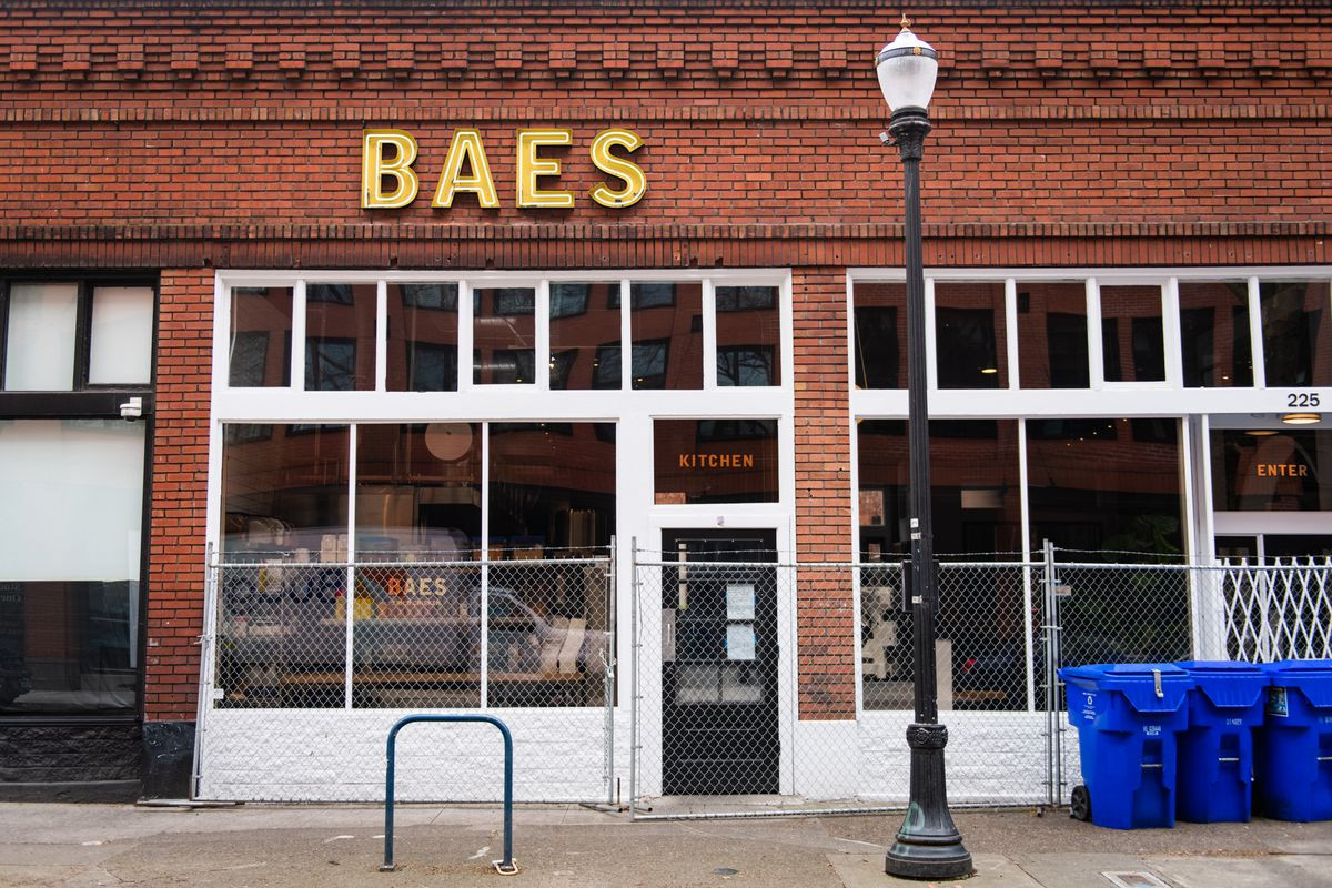 The brick walls of Bae's are guarded by a chainlink fence, keeping customers from walking in through its white-lined doors. The restaurant is open for delivery only, just six months after opening.