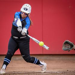 BYU infielder Bridget Fleener (13) hits a foul in the first inning as the University of Utah hosts Brigham Young University at Duke Stadium in Salt Lake City on Wednesday, April 18, 2018.