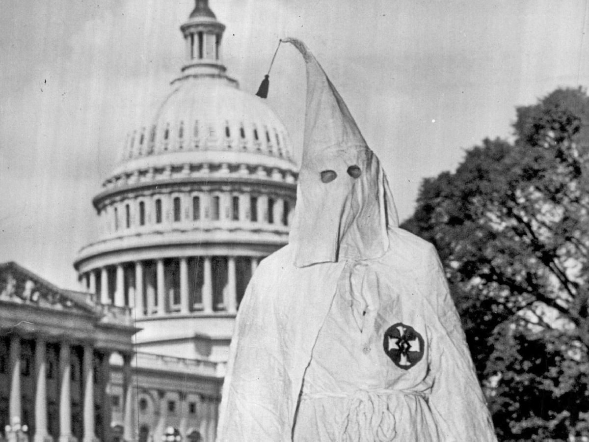 A man dressed in a Ku Klux Klan robe was asked to leave the U.S. Capitol in 1947.   Sun-Times file photos