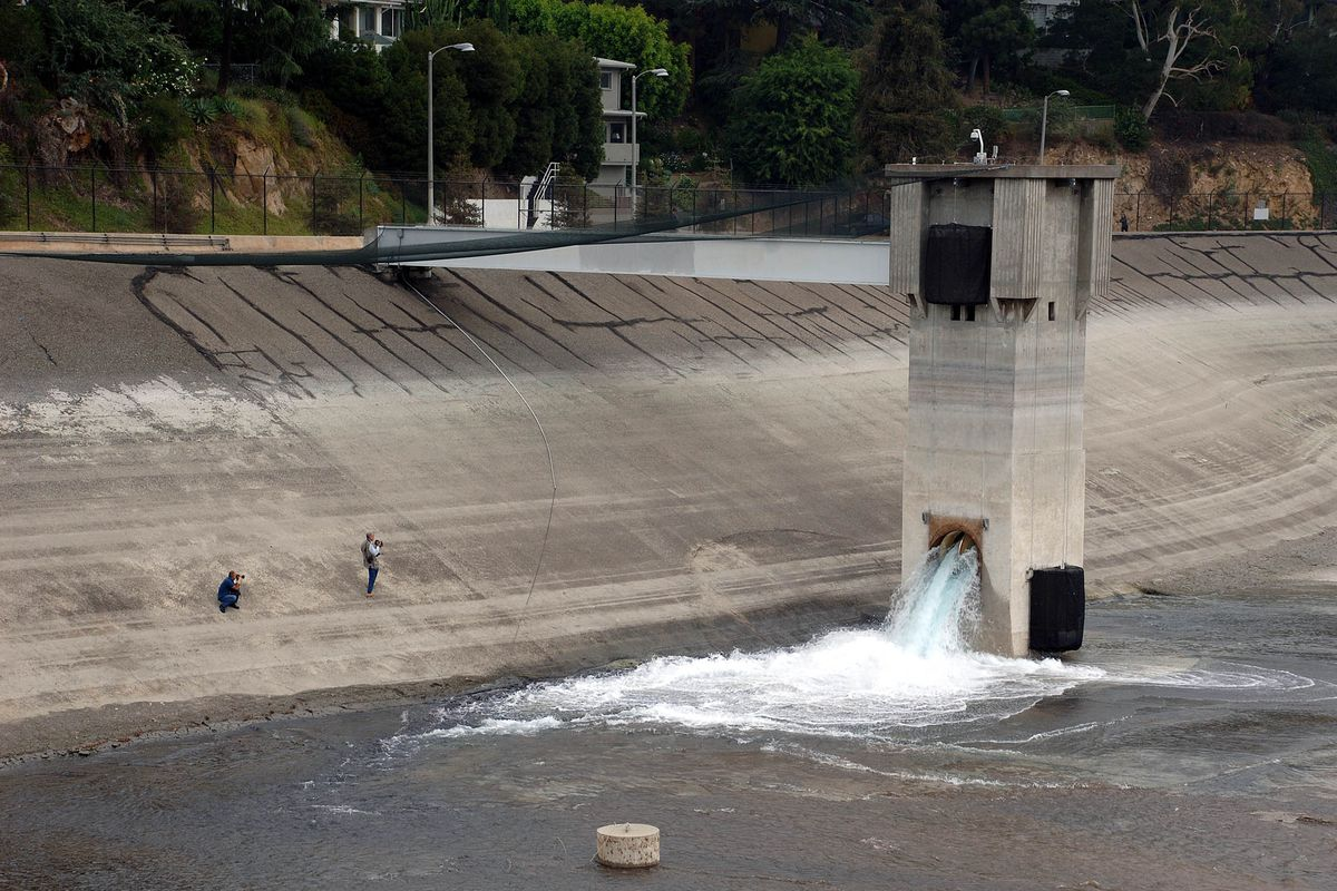 Water pouring back into the empty Silver Lake reservoir