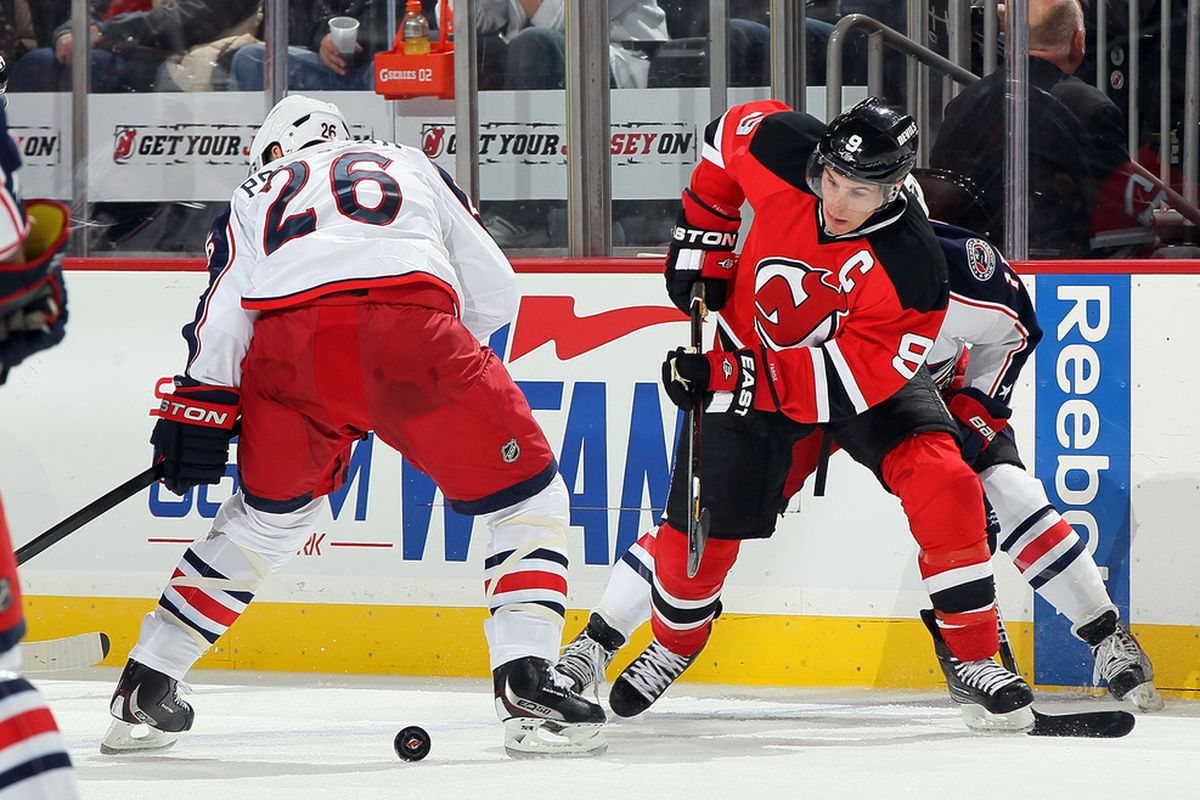 This is Zach Parise fighting for a puck.  Let's hope he and the Devils find more success in doing this in the third period (and the other two) this afternoon on Long Island.  (Photo by Jim McIsaac/Getty Images)