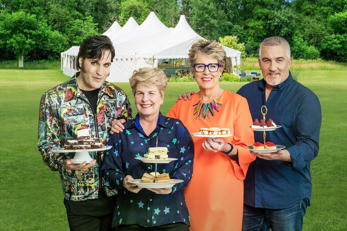 Great British Bake Off 2019 judges Paul Hollywood, Noel Fielding, Prue Leith, and Sandi Toksvig pose with British cakes ahead of the new series on Channel 4