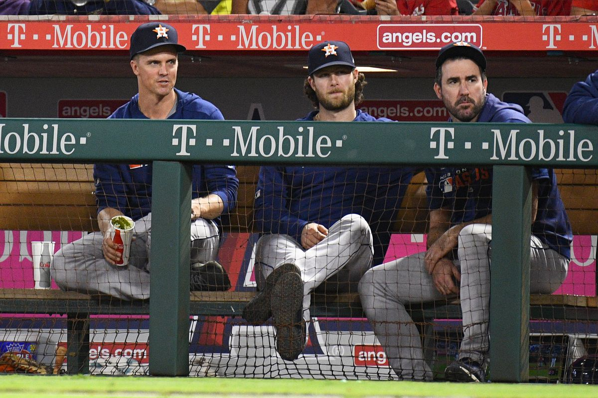 Houston Astros pitchers Zack Greinke, Gerrit Cole  and Justin Verlander look on during a MLB game between the Houston Astros and the Los Angeles Angels of Anaheim on September 26, 2019 at Angel Stadium of Anaheim in Anaheim, CA.