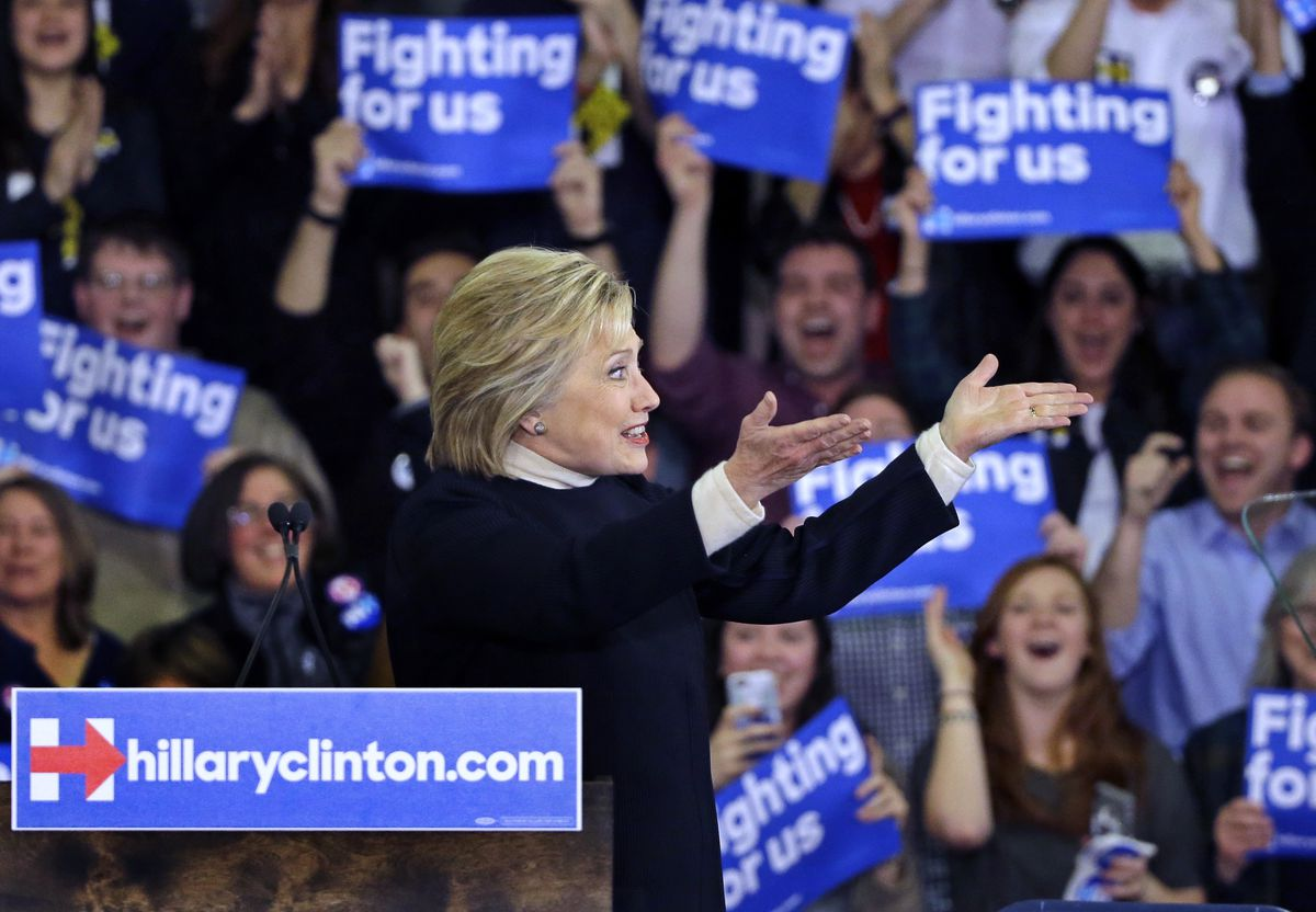 Democratic presidential candidate Hillary Clinton gestures to supporters at her New Hampshire presidential primary campaign rally on Tuesday, Feb. 9, 2016, in Hooksett, N.H. | Elise Amendola/AP