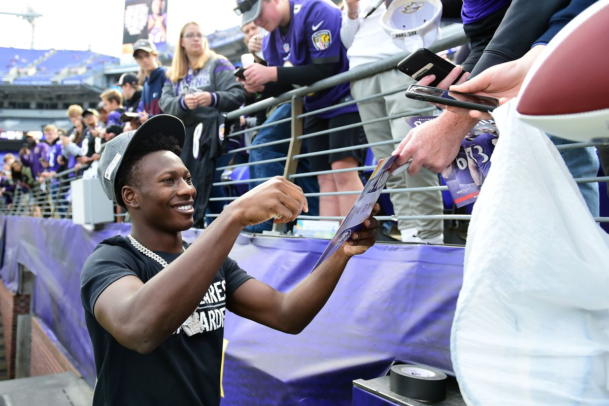 Baltimore Ravens wide receiver Marquise Brown signs autographs for fans prior to the game against the Cincinnati Bengals at M&T Bank Stadium.