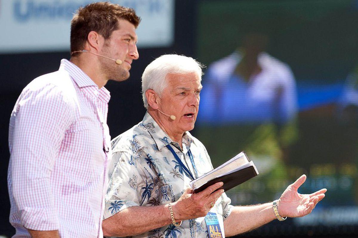 Tim Tebow (left) preaching the gospel