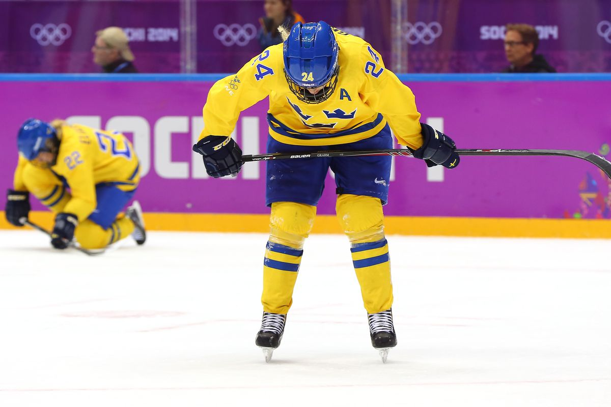 Erika Grahm #24 and Emma Eliasson #22 of Sweden react after losing to Switzerland 4-3 during the Ice Hockey Women's Bronze Medal Game on day 13 of the Sochi 2014 Winter Olympics