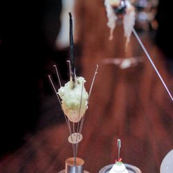 """Using classic Alinea serving pieces, this three-part dish included an antenna holding a crispy pig ear; a tempura battered king crab mix on a vanilla bean """"skewer"""" and a gelatin-based """"shot"""" dubbed the Siam Sunray."""