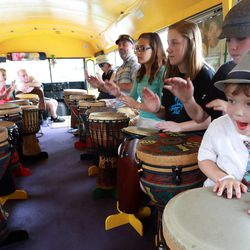 Ty Tuckness, right, plays drums in the DrumBus at Five-O Fest, a free community festival hosted by the Utah Anti-Bullying Coalition, Safe2Help and the Salt Lake City Police Foundation outside of the Public Safety Building in Salt Lake City on Saturday, May 31, 2014.