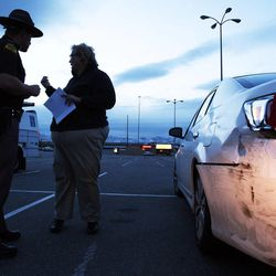 Utah Highway Patrol trooper Carlos Holley talks with Mary Winkler at the scene of a hit-and-run accident in Sandy on Thursday, Dec. 13, 2012.