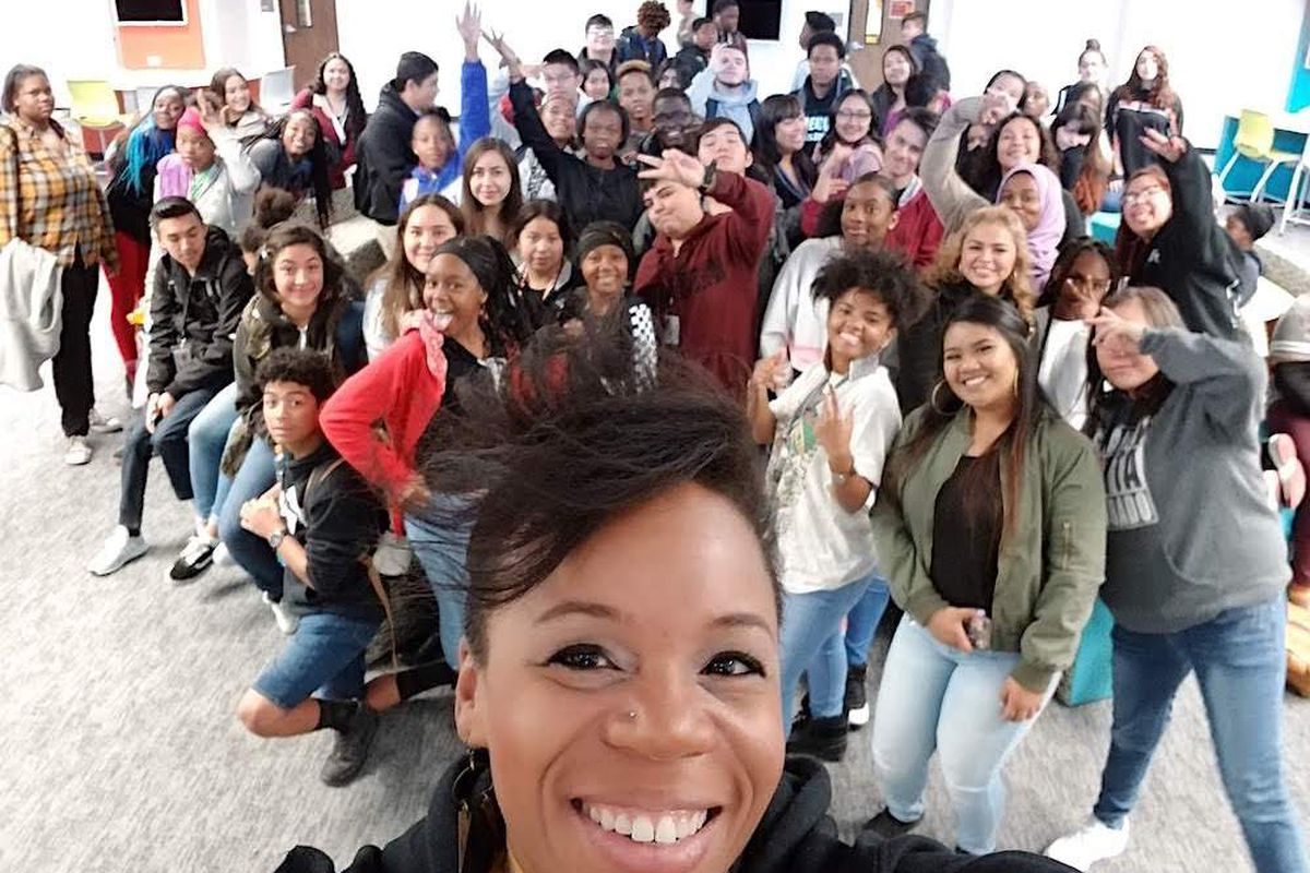 Julia Torres, a school librarian in northeast Denver, with students.