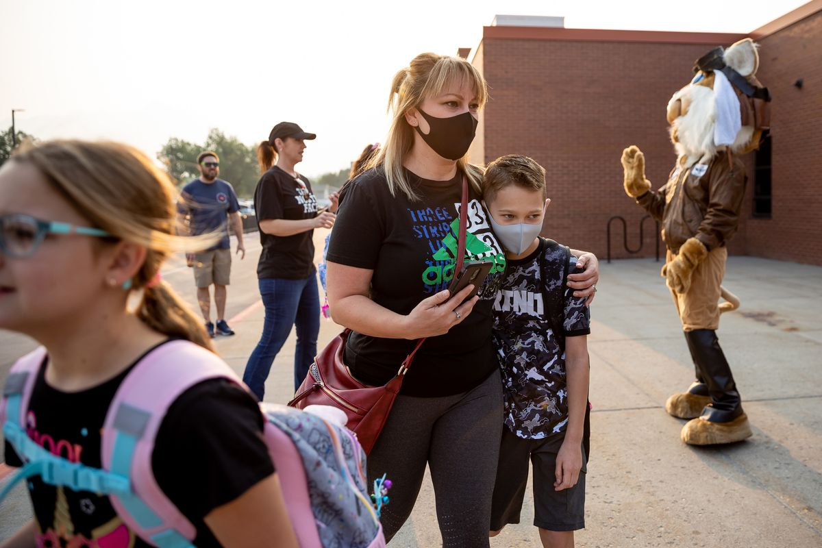Kim Tafoya walks with her son, Dillon, who is entering fifth grade, before the first day of school at Altara Elementary in Sandy.