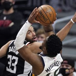 Utah Jazz guard Donovan Mitchell, right, shoots as Los Angeles Clippers forward Nicolas Batum defends during the second half in Game 6 of a second-round NBA basketball playoff series Friday, June 18, 2021, in Los Angeles.