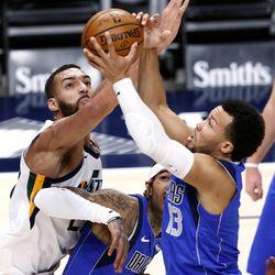 Utah Jazz center Rudy Gobert (27) tries to swat the ball back as Dallas Mavericks guard Jalen Brunson (13) grabs the rebound as the Utah Jazz and the Dallas Mavericks play an NBA basketball game at Vivint Smart Home Arena in Salt Lake City on Wednesday, Jan. 27, 2021.