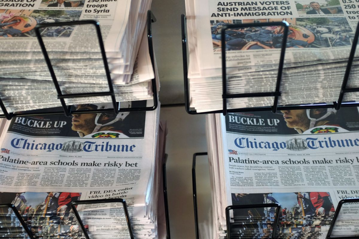 Chicago Tribune newspapers on a sales rack.