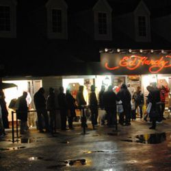This is a line of people outside Ed Hardy. In the rain. At midnight. On Thanksgiving.