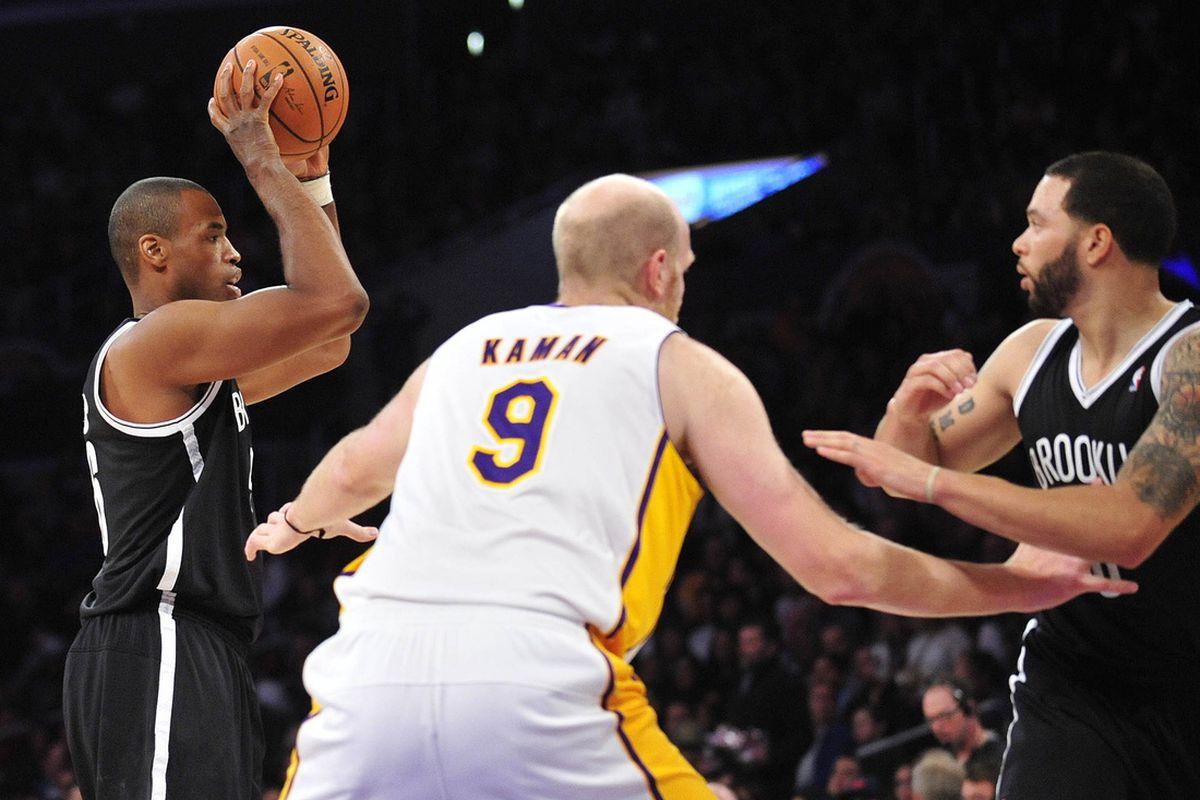 Jason Collins, left, against the L.A. Lakers