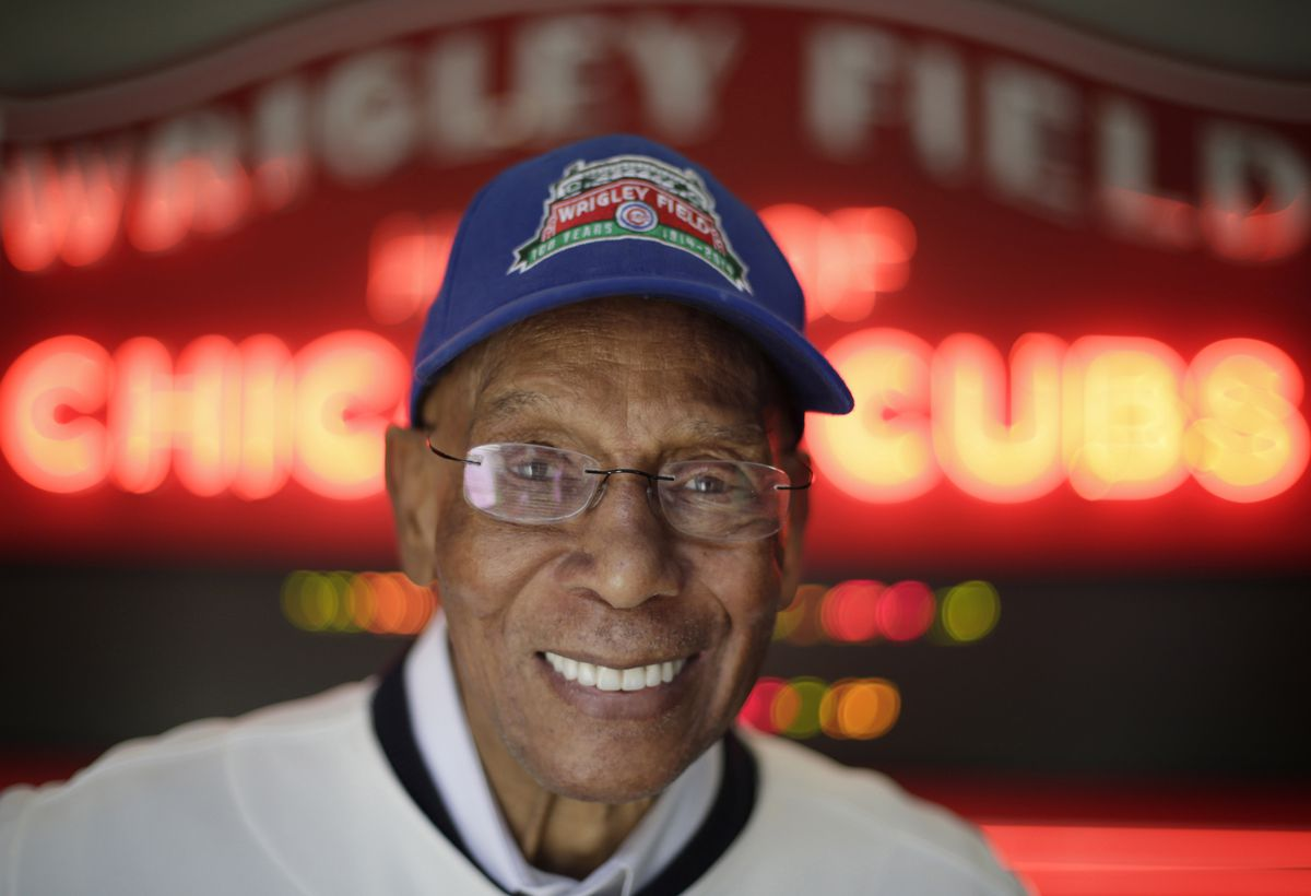 <strong>Chicago Cubs Hall of Fame slugger Ernie Banks smiles after an interview at the Cubs offices in Chicago on March 24, 2014. | M. Spencer Green/AP</strong>