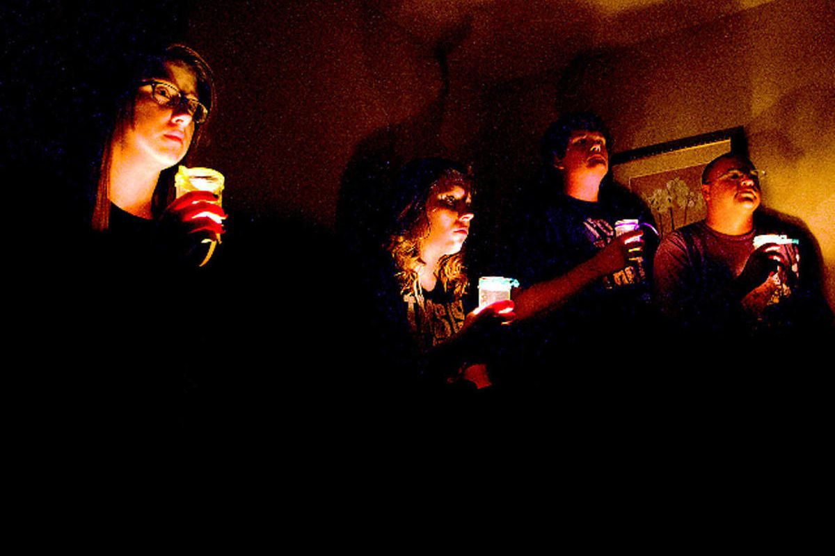 Kierstin Webster, from left, Kelsie Zentner, Brandon Alt and Paul Castillo perform as attendees at a simulated teen party as part of a new Parents R U Ready? event in Gillette, Wyo., on Sept. 20, 2012. The performance, which was done as a tour through a t