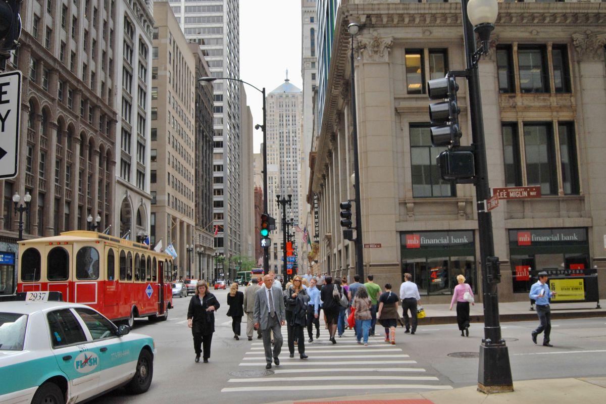 People walking in Chicago Streets across busy street